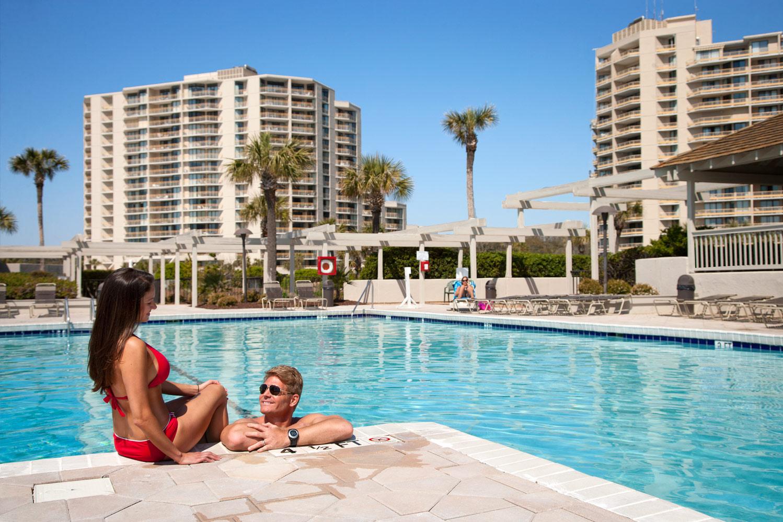 outdoor pool deck at ocean creek resort