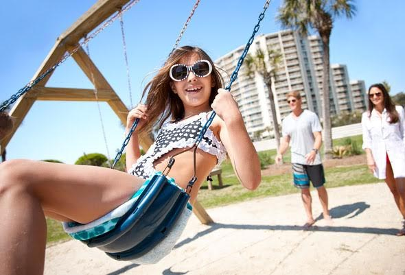 Girl on swing set at Myrtle Beach resort