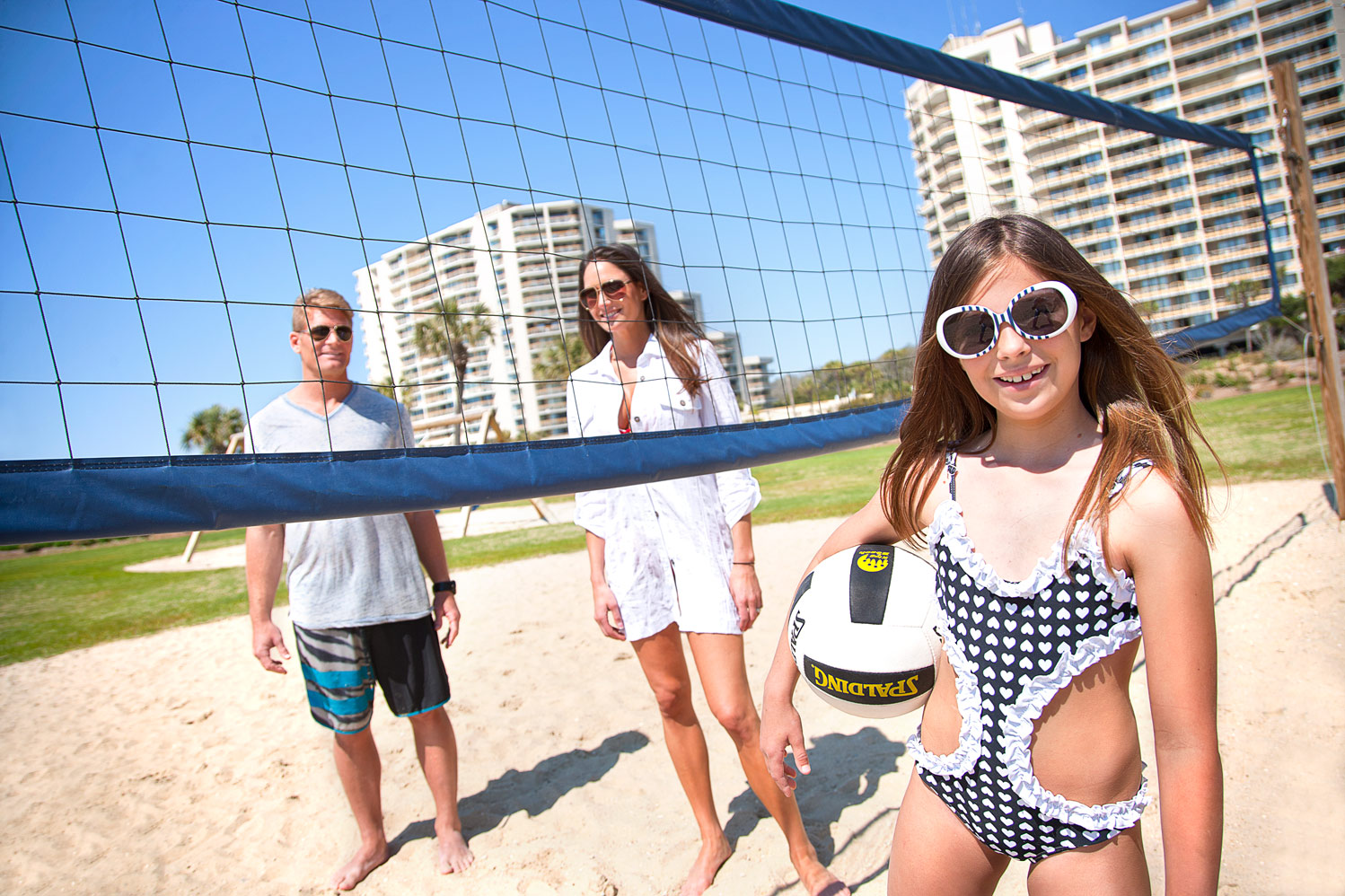 Enjoy a game of beach volleyball with the family!